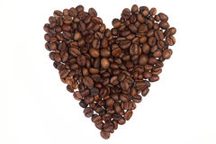 Coffee beans. Brown rosted coffee beans lying on white background, shaped into heart symbol Stock Photos