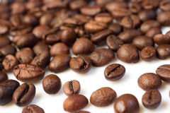 Coffee beans. Brown roasted coffee beans lying on white background (selective focus Royalty Free Stock Photography