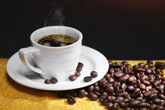 Coffee and beans. Cup of coffee with coffee beans on black background stock photos