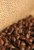 Coffee beans. And jute sack Royalty Free Stock Photography