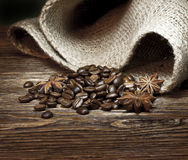 Coffee beans. Against dark wood background Stock Photography