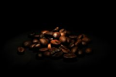 Coffee beans. On the black background Stock Photos