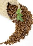 Coffee beans. In the bag with green leaves easy to isolate on white background Royalty Free Stock Photos
