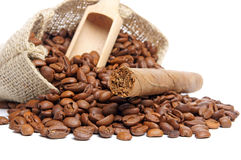 Coffee beans. In a jutesack and cigar royalty free stock images