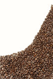 Coffee beans. Closeup of coffee beans on plain background. Copy space Royalty Free Stock Image