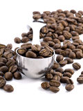 Coffee beans. Spoon full of coffee beans isolated on white background stock photos