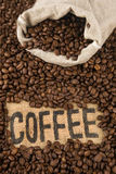 Coffee beans. A bag full coffee beans with label Royalty Free Stock Image