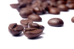 Coffee beans. Close-up shot on white background Stock Images