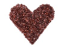 Coffee beans. Brown coffee beans like a heart on isolated white background Royalty Free Stock Photography