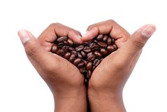 Coffee beans. In a hand like heart - clipping path included Royalty Free Stock Photos