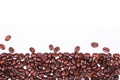 Coffee beans. Border on isolated white background Royalty Free Stock Photo