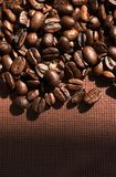 Coffee beans. On dark fabric stock photo
