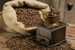 Coffee beans. In sack with the grinder Royalty Free Stock Photos
