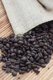 Coffee beans. Fresh coffee beans spilling from a canvas bag Royalty Free Stock Image