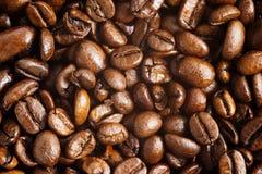 Coffee beans. Macro background Stock Photos