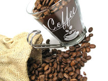Coffee and beans. Coffee beans and coffee in a glass Royalty Free Stock Photography