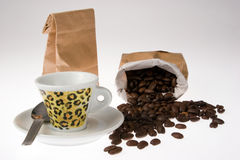Coffee beans. Cup and coffee beans in the bag Royalty Free Stock Images