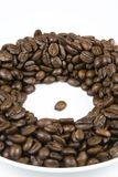 Coffee Beans. In a saucer on a white background Stock Photo