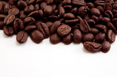 Coffee Beans. Against a white background. Copy space available for adding text etc. at bottom Royalty Free Stock Photo