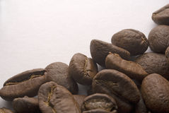 Coffee Beans. Some coffee beans isolated on white Royalty Free Stock Images