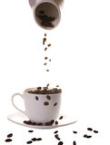 Coffee beans. Pouring coffee beans in a cup of coffee Stock Photo