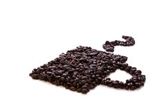 Coffee beans. Some coffee beans on a white background Royalty Free Stock Photo