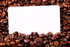 Coffee beans. Against the backdrop of coffee beans is a business card Royalty Free Stock Image