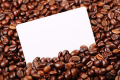 Coffee beans. Against the backdrop of coffee beans is a business card Stock Photography
