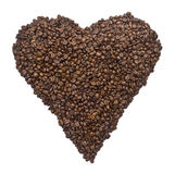 Coffee beans aligned to shape a heart Stock Photos