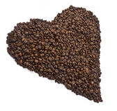 Coffee beans aligned to shape a heart. Royalty Free Stock Photos