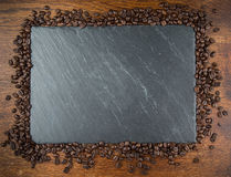 Coffee beans along a slate board Stock Image