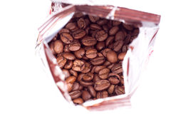 Coffee beans in aluminum foil bag package. Coffee beans in open aluminum foil bag package Royalty Free Stock Photography