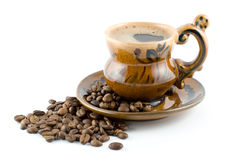 Coffee Beans And Black Coffee In A Cup Stock Photo