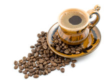 Coffee Beans And Black Coffee In A Cup Royalty Free Stock Photography