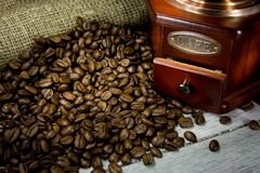 Free Coffee Beans And Wood Grinder On Sacking Royalty Free Stock Image - 16976506
