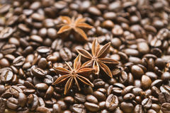 Coffee beans and anise. Anise seeds on the background of coffee beans Royalty Free Stock Photo