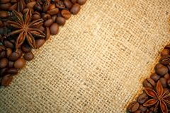 Coffee beans and anise stars on burlap. Creating space for text stock photo