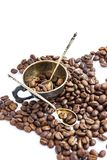 Coffee beans and antuque cup and spoons on white background. Coffee beans and antuque cup and spoons on white stock images