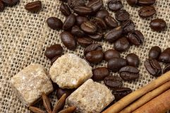Coffee Beans Arabica. Canvas Background. Close-up photo. background with the addition of anise and cinnamon royalty free stock images