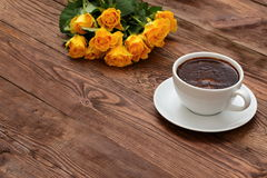 Coffee beans. Aromatic coffee and a bouquet of beautiful roses Stock Image