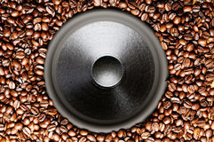 Coffee beans around the bass speaker Royalty Free Stock Images