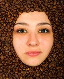 Coffee beans around face Stock Photos