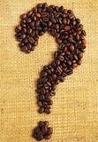 Coffee beans arranged as question mark on textured background Stock Photos