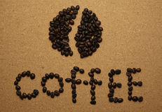Coffee beans are arranged into English letters Royalty Free Stock Photos