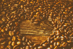 Coffee beans arranged in a heart shape. The effect of film grain. Stock Photos