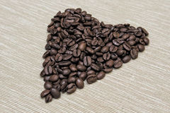 Coffee beans arranged in a heart shape Royalty Free Stock Images