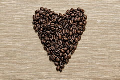 Coffee beans arranged in a heart shape Stock Photo