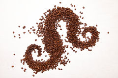 Coffee beans arranged like some smoke. Coffee beans arranged like some ornaments or smoke Royalty Free Stock Photo