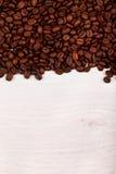 Coffee beans as border on white Royalty Free Stock Photo