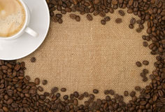Coffee beans as a frame, and a cup of coffee Stock Photography